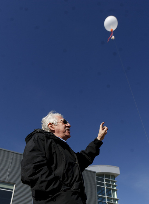 Trent Nelson  |  The Salt Lake Tribune Russ Schnell, a deputy director with NOAA, demonstrates a balloon used to check air quality as government agencies and industry announced a Uinta Basin winter ozone study.