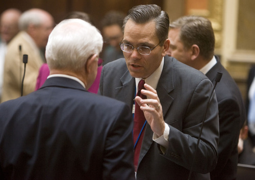 Al Hartmann  |  Tribune file photo Rep. Kenneth Summison, right, speaks to Rep. Kay McIff on the House floor.