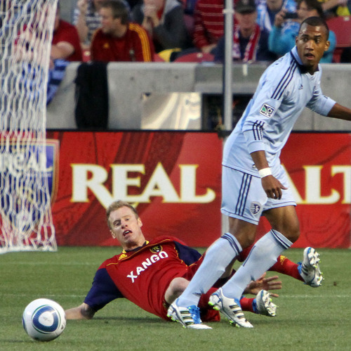 Real Salt Lake defender Nat Borchers looses the ball to Kansas City forward Teal Bunbury in the first half in Rio Tinto Stadium. Stephen Holt/ Special to the Tribune