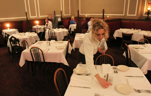 Francisco Kjolseth     The Salt Lake Tribune Server Sherrie Tuttle prepares tables at Lamb's Grill on Main Street in downtown Salt Lake City.