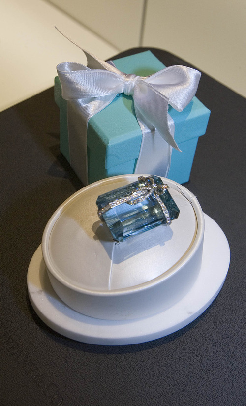 Paul Fraughton | The Salt Lake Tribune A $100,000 brooch with a 73-carat aquamarine and 82 round diamonds on display at the new Tiffany store opening in City Creek Center.