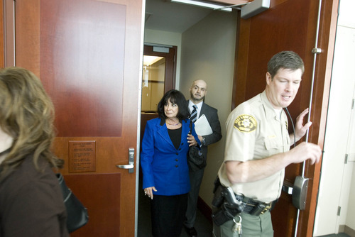 Paul Fraughton | The Salt Lake Tribune Rob Manzanares and his mother, Elizabeth, leave  the courtroom after a Wednesday hearing on the custody of Rob Manzanares' daughter, given up at birth without his consent.