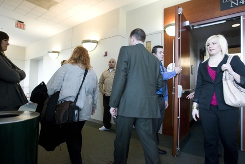 Paul Fraughton | The Salt Lake Tribune  Jake Strickland, who is dealing with a similar situation as Rob Manzanares, holds the door for his sister Heidi Strickland as they exit the courtroom Wednesday.
