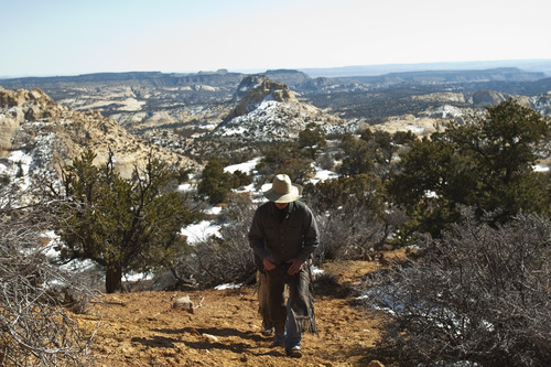 Chris Detrick     The Salt Lake Tribune Cowboy Norm Neilson, from Tropic, walks around Rock Springs Point along the west edge of the Grand Staircase-Escalante National Monument on Saturday, Feb. 18, 2012.