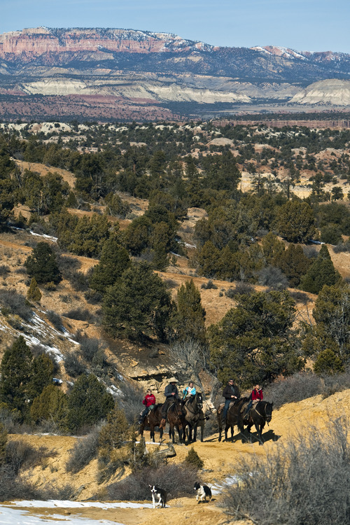 Chris Detrick     The Salt Lake Tribune Horseback riders go along the trail to Rock Springs Point along the west edge of the Grand Staircase-Escalante National Monument on Saturday, Feb. 18, 2012.