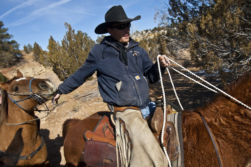 Chris Detrick     The Salt Lake Tribune Cowboy Hoot Hatch, of Panguitch, rides to Rock Springs Point along the west edge of the Grand Staircase-Escalante National Monument on Saturday, Feb. 18, 2012.
