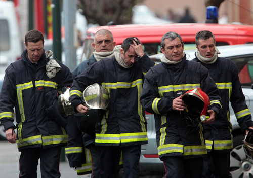 Bob Edme  |  The Associated Press French firefighters leave after a police assault on a suspected Islamic extremist holed up in an apartment in Toulouse, southwestern France, Thursday, March 22, 2012. Mohamed Merah, who boasted of killing seven people to strike back at France died Thursday after jumping from his window, gun in hand, in a fierce shootout with police, a French minister said.