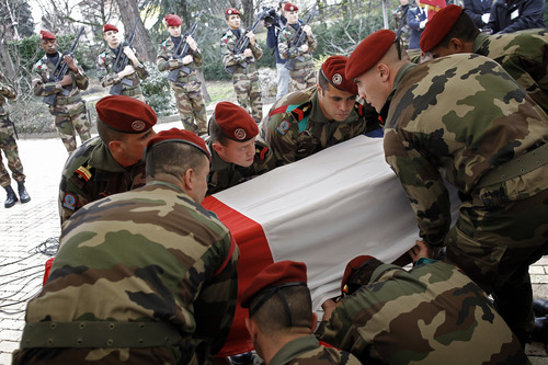 Soldiers carry the coffin of French paratrooper Mohamed Legouad during his funeral in the Grand Mosque of Lyon, central France, Thursday, March 22, 2012. Legouad was killed in Montauban by a suspected French Islamic extremist who is believed to have also killed three Jewish schoolchildren, a rabbi, and two other French paratroopers in separate incidents. (AP Photo/Laurent Cipriani)