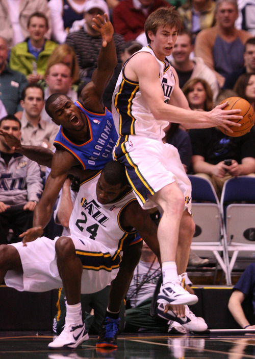 Leah Hogsten  |  The Salt Lake Tribune Utah Jazz's Gordon Hayward comes down with the rebound as the Thunder's Serge Ibaka falls on Paul Millsap during the first half against Oklahoma City Thunder, Tuesday, March 20, 2012, at the Energy Solutions Arena in Salt Lake City, Utah .