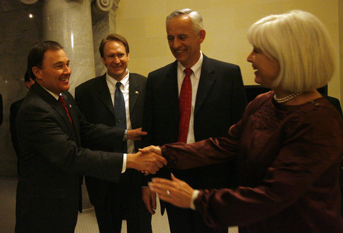 File  |  The Salt Lake Tribune  Sen. Mark Madsen, second from left, shakes hands with Gov. Gary Herbert, left, and Sens. Micahel Waddoups and Pat Jones.