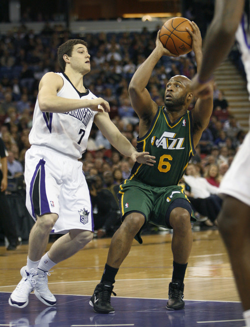 Utah Jazz guard Jamaal Tinsley (6) looks for an opening against Sacramento Kings guard Jimmer Fredette (7) during the first half of an NBA basketball game in Sacramento, Calif., Thursday, March 22, 2012. (AP Photo/Steve Yeater)