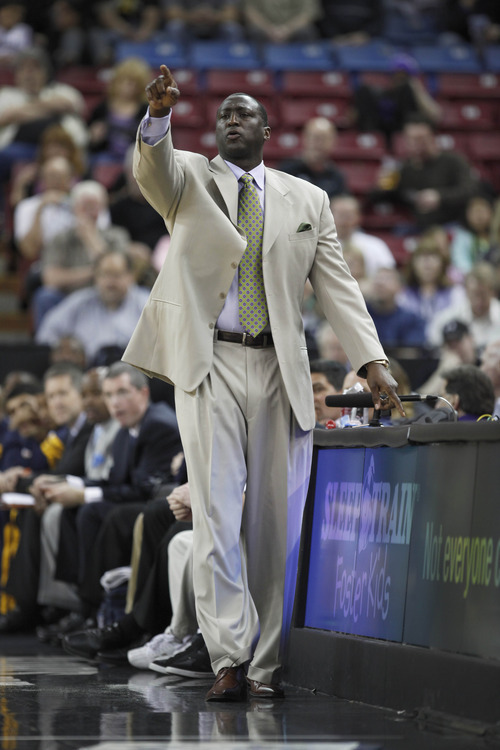 Utah Jazz head coach Tyrone Corbin directs his team against the Sacramento Kings during the first half of an NBA basketball game in Sacramento, Calif., Thursday, March 22, 2012. (AP Photo/Steve Yeater)