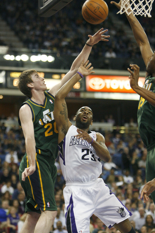 Sacramento Kings guard Marcus Thornton (23) shoots over Utah Jazz during defender Gordon Hayward (20) during the second half of an NBA basketball game in Sacramento, Calif., Thursday, March 22, 2012. The Jazz won 103-102.(AP Photo/Steve Yeater)
