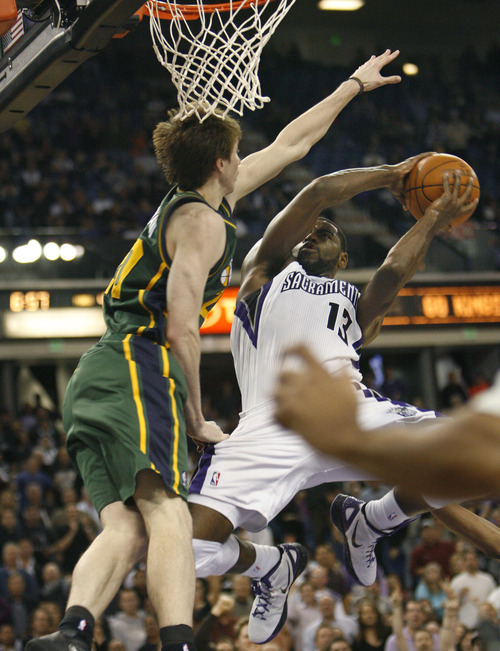 Sacramento Kings guard Tyreke Evans (13) drives to the basket against Utah Jazz forward Gordon Hayward during the second half of an NBA basketball game in Sacramento, Calif., Thursday, March 22, 2012. The Jazz won 103-102.(AP Photo/Steve Yeater)