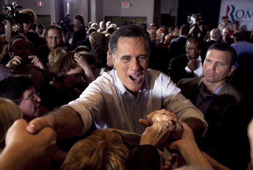 Republican presidential candidate, former Massachusetts Gov. Mitt Romney greets supporters during a campaign stop at an American Legion post in Arbutus, Md., Wednesday, March 21, 2012. (AP Photo/Steven Senne)