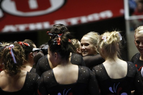 Chris Detrick  |  The Salt Lake Tribune Kyndal Robarts is congratulated by her teammates after competing on the beam during the gymnastics meet against Utah State at the Huntsman Center Friday January 13, 2012.