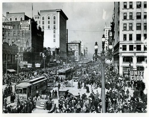 Tribune file photo  People crowd the streets to celebrate the end of WWI on Nov. 11, 1918.