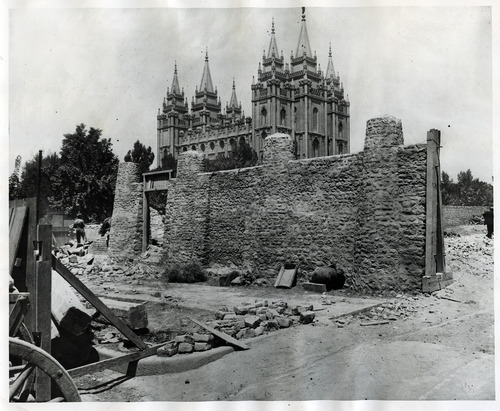 Tribune file photo  A portion of a stone wall is seen as it is torn down in the 1870s to make way for other buildings at Temple Square.