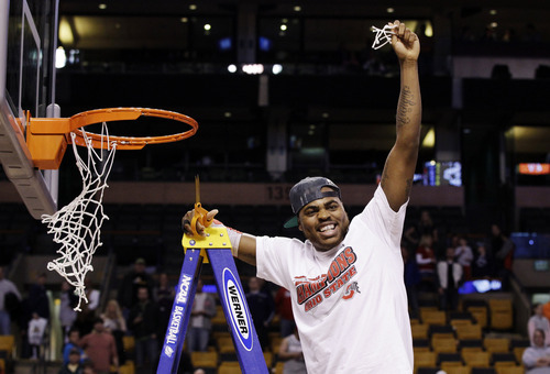 Ohio State's Deshaun Thomas cuts down the net after his team defeated Syracuse 77-70 in the East Regional final game in the NCAA men's college basketball tournament, Saturday, March 24, 2012, in Boston. (AP Photo/Elise Amendola)