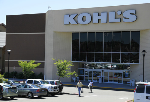 In this Aug. 8, 2011 photo, shoppers enter and exit the Kohl's store in San Rafael, Calif. Kohl's Corp. is reporting that its second-quarter profits rose 17 percent Thursday, Aug. 11, as the mid-brow department store chain's expense controls and success in its store-label brands offset modest revenue growth. The company says it's increasing its profit guidance.  (AP Photo/Eric Risberg)