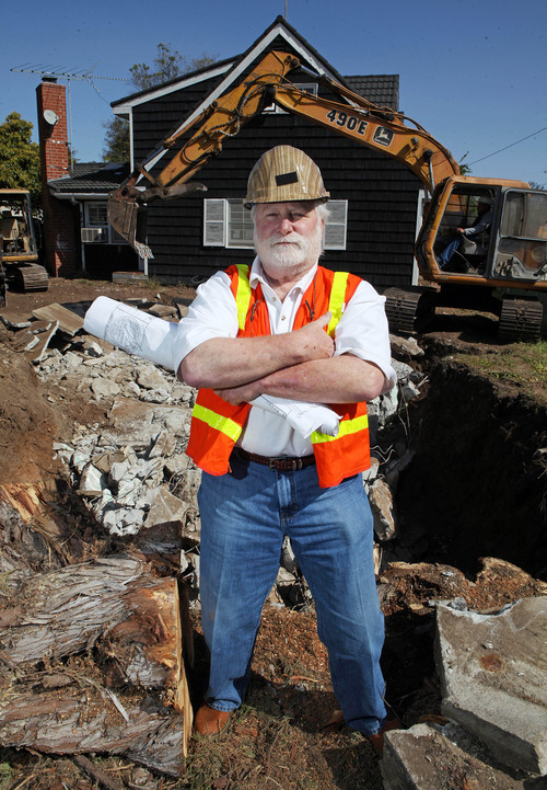 In this March 7, 2012 photo, Ron Fox, owner of Central Reclamation, with equipment operator Jose Quiros, poses at the site of a home his company is demolishing in the Pacific Palisades area of Los Angeles.  (AP Photo/Reed Saxon)