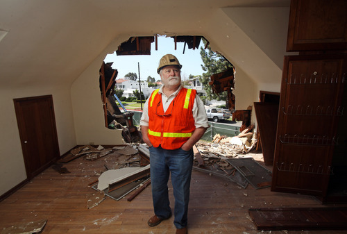 In this March 7, 2012 photo, Ron Fox, owner of Central Reclamation, poses at the site of a home his company is demolishing in the Pacific Palisades area of Los Angeles.  (AP Photo/Reed Saxon)