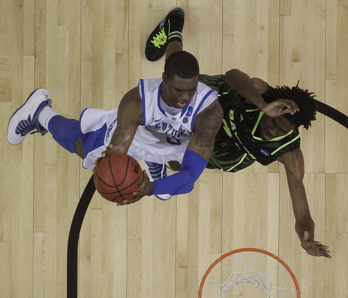 Kentucky's Terrence Jones (3) heads to the hoop as Baylor's Anthony Jones defends during the second half of an NCAA tournament South Regional finals college basketball game Sunday, March 25, 2012, in Atlanta. (AP Photo/John Bazemore)