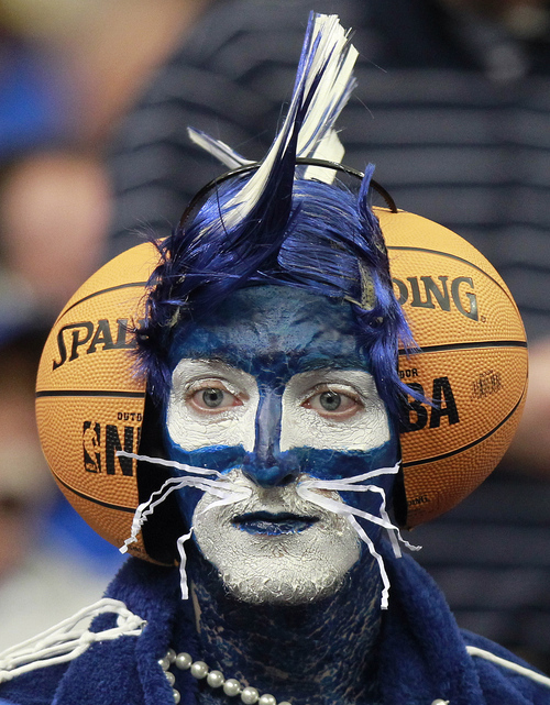 A Kentucky fan watches practice before the first half of an NCAA tournament South Regional finals college basketball game against Baylor, Sunday, March 25, 2012, in Atlanta.  (AP Photo/John Bazemore)