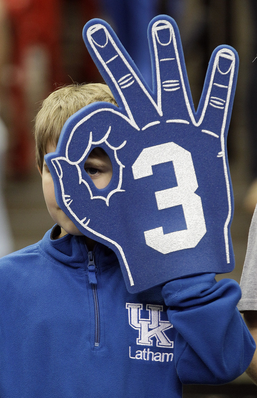 A Kentucky fan watches practice before the first half of an NCAA tournament South Regional finals college basketball game against Baylor, Sunday, March 25, 2012, in Atlanta. (AP Photo/David J. Phillip)
