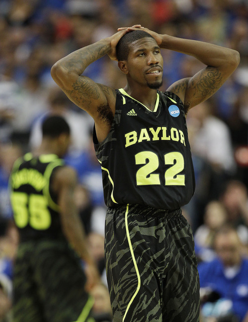 Baylor's A.J. Walton (22) reacts to play against Kentucky during the second half of an NCAA tournament South Regional finals college basketball game Sunday, March 25, 2012, in Atlanta. (AP Photo/David J. Phillip)