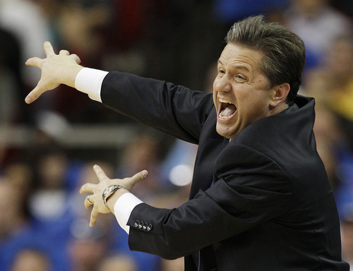 Kentucky head coach John Calipari reacts to play against Baylor during the second half of an NCAA tournament South Regional finals college basketball game Sunday, March 25, 2012, in Atlanta. (AP Photo/David J. Phillip)
