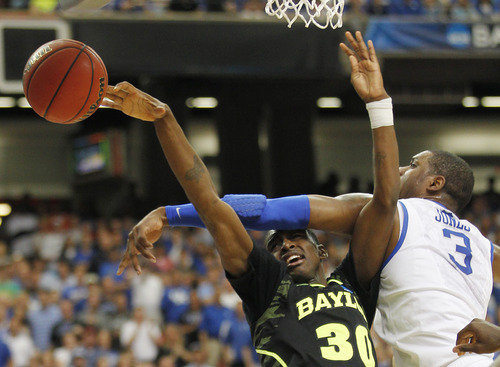 Kentucky's Terrence Jones (3) works against Baylor's Quincy Miller during the first half of an NCAA tournament South Regional finals college basketball game Sunday, March 25, 2012, in Atlanta. (AP Photo/John Bazemore)