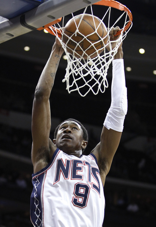 New Jersey Nets' MarShon Brooks scores a basket in the third quarter of an NBA basketball game against the Utah Jazz, Monday, March 26, 2012, in Newark, N.J. The Jazz won 105-84. (AP Photo/Julio Cortez)