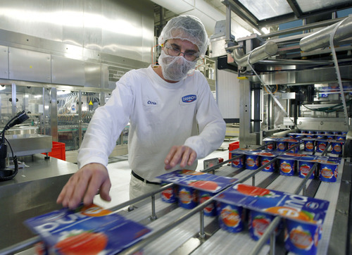 Al Hartmann  |  The Salt Lake Tribune Dannon Production operator Chris Shevey quality checks six-packs of Pure yogurt at the end of the production process.  Dannon's West Jordan plant is making a new, low cost yogurt called Pure. It is made with a few simple, natural ingredients but has the beneficial live and active cultures. Cost is $1.99 for a six-pack.