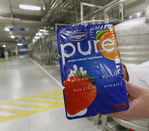 Al Hartmann  |  The Salt Lake Tribune Dannon's West Jordan plant is making a new, low cost yogurt called Pure. It is made with a few simple, natural ingredients but has the beneficial live and active cultures. Cost is $1.99 for a six-pack.