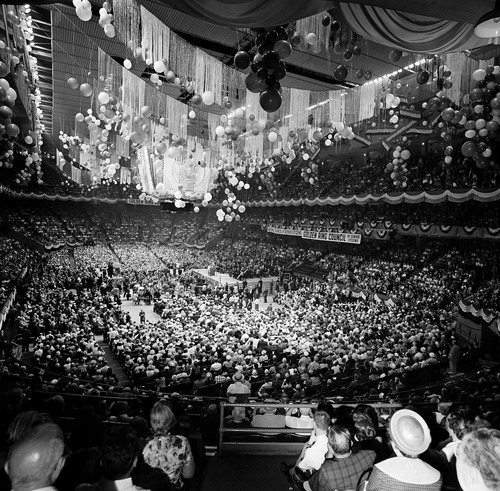 FILE - In this May 20, 1962, file photo elderly citizens fill New York's Madison Square Garden to capacity as they hold a mass rally to hear President John F. Kennedy speak in support of his administration's program for medical care for the elderly. The president said the arguments against his Medicare program are the same ones raised 25 years ago when social security was proposed. Though he made health care a major campaign issue, as president can't get a plan for the elderly through Congress. (AP Photo/File)