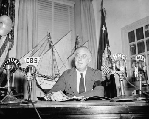 FILE - In this Sept. 7, 1942, file photo President Franklin Roosevelt addresses the nation via radio and repeated his message to Congress, that it must pass anti-inflation laws by October 1 or that he will take the matter in his own hands and use his executive power to bring about