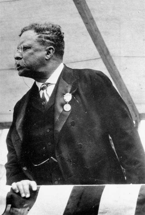 FILE - In this photo taken in 1912 Theodore Roosevelt campaigns for President. Roosevelt champions national health insurance and tries to ride his progressive Bull Moose Party back to the White House. It's an idea ahead of its time; health insurance is a rarity and medical fees are relatively low because doctors cannot do much for most patients. But medical breakthroughs are beginning to revolutionize hospitals and drive up costs. Roosevelt loses the race.  (AP Photo/Brown Brothers)