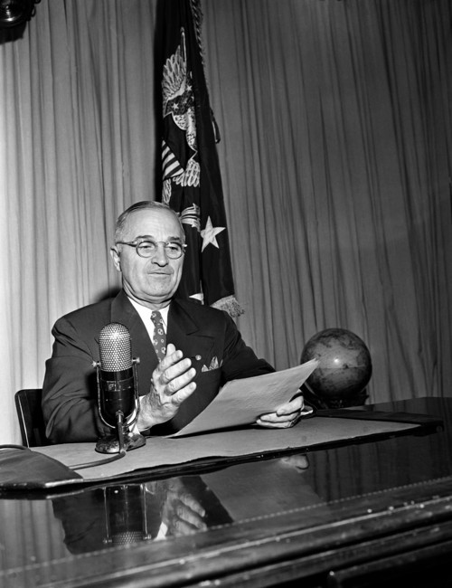 FILE - In this Sept. 1, 1945, file photo President Harry Truman broadcasts his message on the formal surrender of Japan from the White House in Washington. Truman called on Congress in 1945 to create a national insurance program for those who pay voluntary fees, saying medical care is a right of all Americans. The American Medical Association denounces the idea as