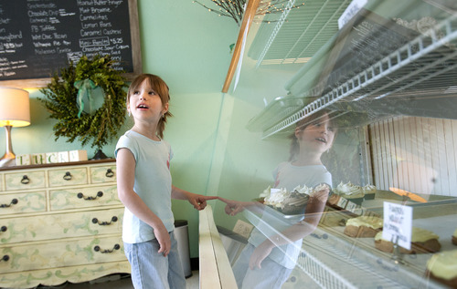 Leah Hogsten  |  The Salt Lake Tribune Maria Peterson, 6, has a hard time deciding which cupcake is her absolute favorite at the Sweet Cake Bake Shop while on an outing with her mother. Allison Regan, owner of Sweet Cake Bake Shop in Kaysville, says the demand for her gluten-free products is nationwide. Her bakery ships flour, cakes and cookies as far as Alaska, with more customers registered on her website in Texas than Utah.