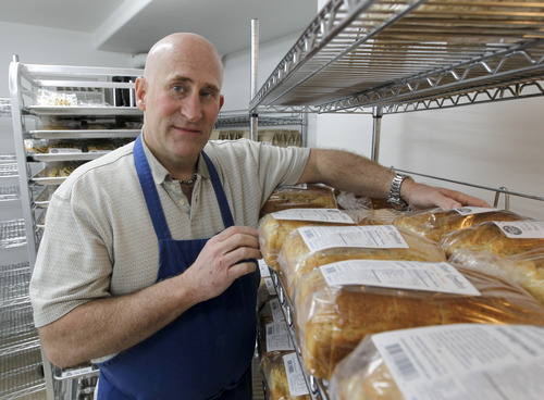 Al Hartmann  |  The Salt Lake Tribune Tim Lawson, founder of New Grains Gluten-Free Bakery, stacks fresh white and whole grain gluten-free baked breads March 23 in the basement of his Provo home.