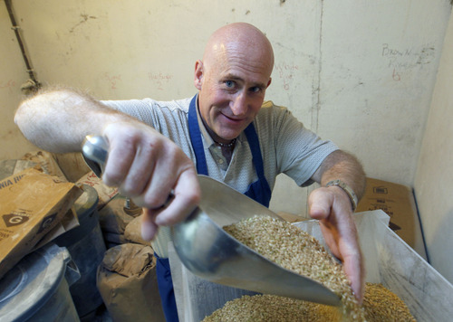 Al Hartmann  |  The Salt Lake Tribune Tim Lawson,  founder of New Grains Gluten-Free Bakery scoops brown rice into a grinder Friday March 23 in the basement of his Provo home.
