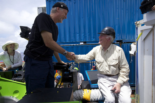 Filmmaker  and National Geographic Explorer-in-Residence James Cameron is congratulated by ocean explorer and U.S. Navy Capt. Don Walsh, right, after completing the first ever solo dive to the