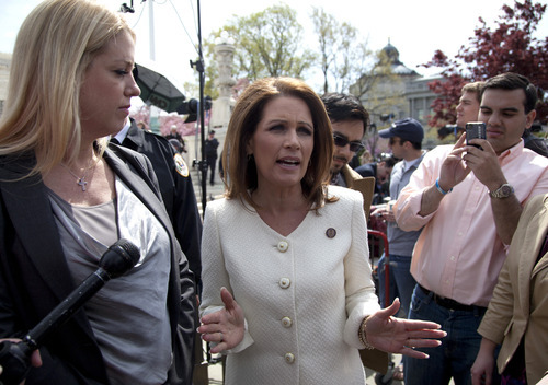 Rep. Michele Bachmann, R-Minn., right, accompanied by Florida Attorney General Pam Bondi, speaks in front of the Supreme Court in Washington, Wednesday, March 28, 2012, as the court concluded three days of hearing arguments on the constitutionality of President Barack Obama's health care overhaul. (AP Photo/Carolyn Kaster)