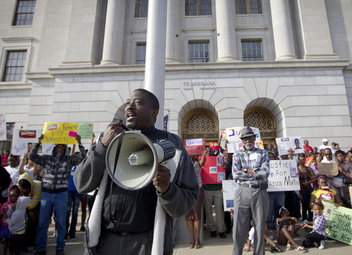 Rev. Anthony Ware addresses a crowd on the steps of the Federal Courthouse on Wednesday, March, 28, 2012, in Texarkana, Ark. Demonstrators gathered to call for justice for slain teenager Trayvon Martin, who was wearing a hoodie and getting candy when he was shot and killed by a community watch volunteer last month in Florida. (AP Photo/The Texarkana Gazette, Evan Lewis)