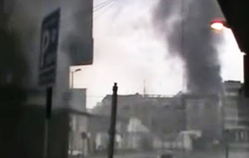 This image made from amateur video and released by the Syria media center Thursday, March 29, 2012, purports to show black smoke riding from buildings in Homs, Syria. Syrian President Bashar Assad says he will spare no effort to make the mission of U.N.-Arab League envoy Kofi Annan a success but he demands that armed opponents commit to halting violence. (AP Photo/Syria Media Center via APTN) THE ASSOCIATED PRESS CANNOT INDEPENDENTLY VERIFY THE CONTENT, DATE, LOCATION OR AUTHENTICITY OF THIS MATERIAL. TV OUT