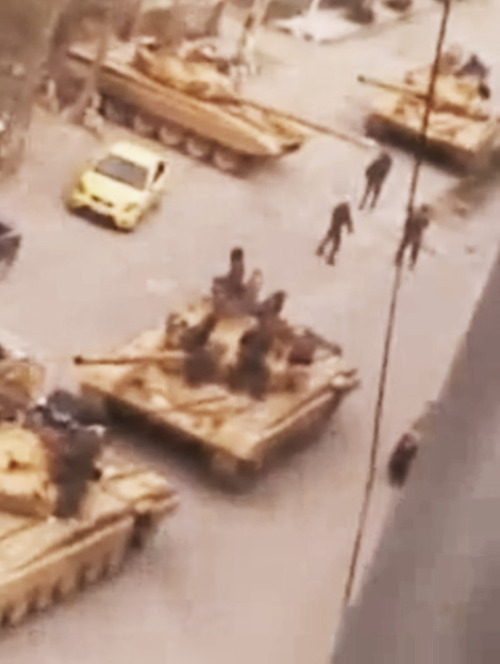 This image made from amateur video and released by Shaam News Network Wednesday, March 27, 2012, purports to show Syrian military tanks in Damascus, Syria. Syrian activists said Wednesday a government offensive in northern Syria during which troops overran a major opposition stronghold has left behind scenes of destruction, with corpses in the streets, homes burned to the ground and shops that have been pillaged and looted. (AP Photo/Shaam News Network via APTN) THE ASSOCIATED PRESS CANNOT INDEPENDENTLY VERIFY THE CONTENT, DATE, LOCATION OR AUTHENTICITY OF THIS MATERIAL. TV OUT