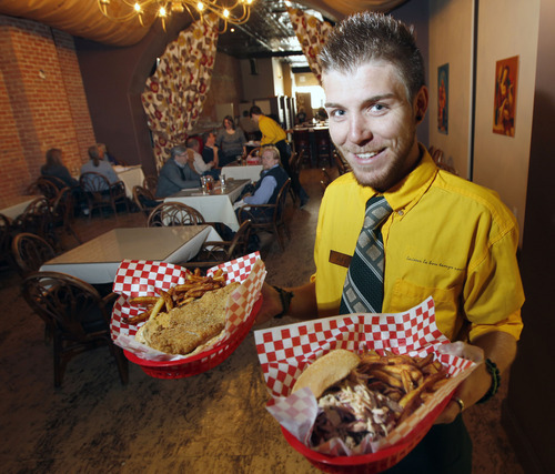 Al Hartmann  |  The Salt Lake Tribune Soul & Bones' bartender Jake Murray serves up a Catfish Basket, left, with a pulled-pork sandwich with fries and coleslaw.