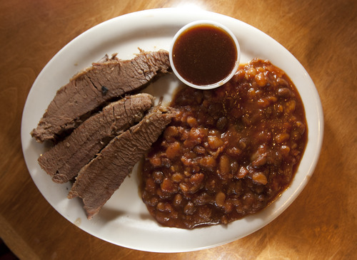 Leah Hogsten  |  The Salt Lake Tribune Smedley Manor, a barbecue restaurant, in Bountiful, March 22, 2012. The beef brisket, your choice of sauce with a side of baked beans.