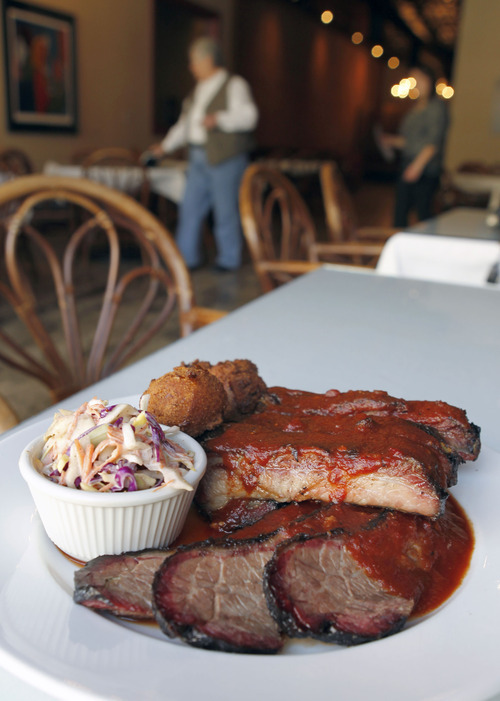 Al Hartmann  |  The Salt Lake Tribune Soul & Bones' smoked St. Louis Ribs, and beef brisket with deep-fried hush puppies and coleslaw.